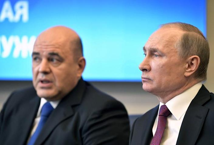 FILE PHOTO: Russian President Putin attends a meeting with head of the Federal Taxation Service Mishustin in Moscow