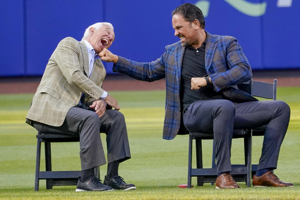 Former New York Mets catcher Mike Piazza, right, and former Mets manager Bobby Valentine joke around during a Mets Hall of Fame induction ceremony, Saturday, July 31, 2021, in New York. (AP Photo/Mary Altaffer)