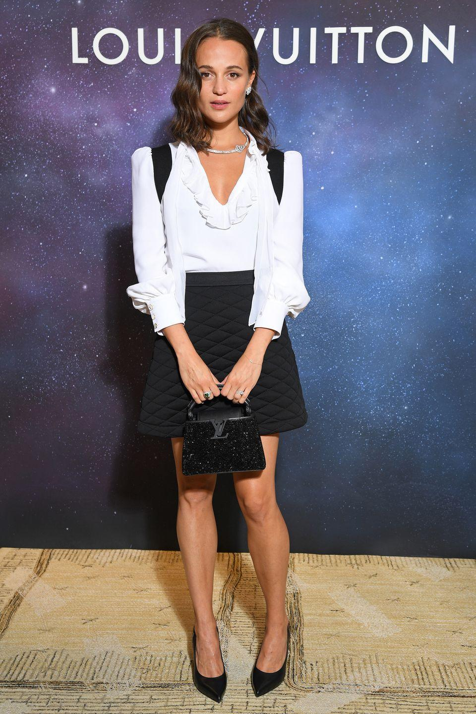 <p><strong>28 September </strong>Alicia Vikander went for a classic shirt and quilted mini-skirt at the Louis Vuitton cocktail party in Paris. </p>