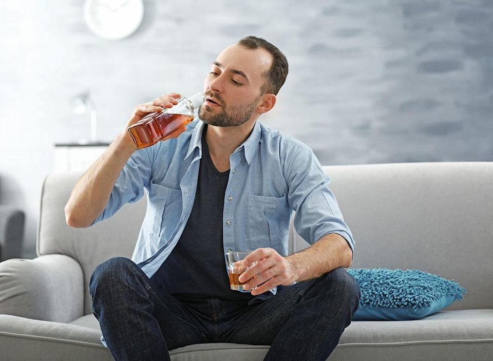 man drinking from liquor bottle - how does alcohol affect the brain