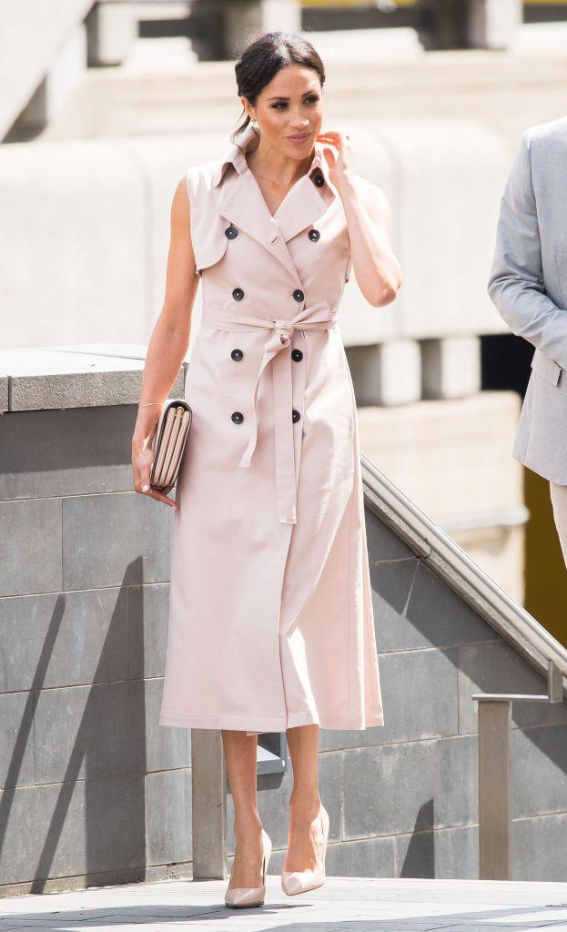 """<p>Meghan Markle stepped out in a blush-colored trench dress by <a class=""""link rapid-noclick-resp"""" href=""""https://www.houseofnonie.com/the-brand.html"""" rel=""""nofollow noopener"""" target=""""_blank"""" data-ylk=""""slk:House of Nonie"""">House of Nonie</a> paired with a matching clutch from Mulberry and coordinating Dior pumps. She wore the look <a href=""""https://www.townandcountrymag.com/style/fashion-trends/a22200767/meghan-markle-classic-trench-coat-nelson-mandela-exhibit/"""" rel=""""nofollow noopener"""" target=""""_blank"""" data-ylk=""""slk:while attending"""" class=""""link rapid-noclick-resp"""">while attending</a> the opening of the Nelson Mandela Centenary Exhibition with Prince Harry.</p>"""