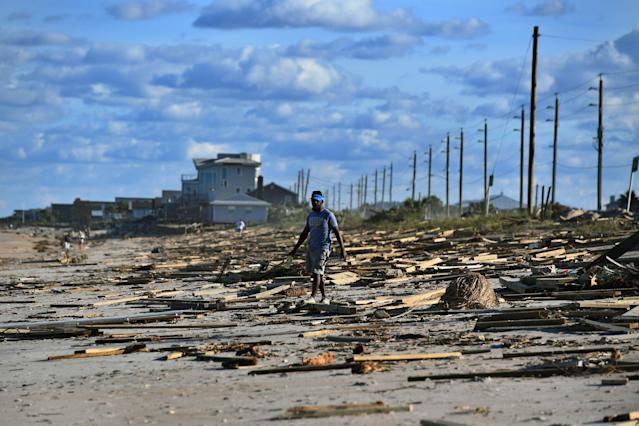 <p>A man walks on a debris covered beach in St. Augustine, Fla., on Oct. 8, 2016, after Hurricane Matthew passed the area. (Photo: Jewel Samad/AFP/Getty Images) </p>