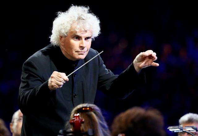 FILE PHOTO - Conductor Simon Rattle takes part in the opening ceremony of the London 2012 Olympic Games at the Olympic Stadium July 27, 2012. REUTERS/Kai Pfaffenbach/File Photo