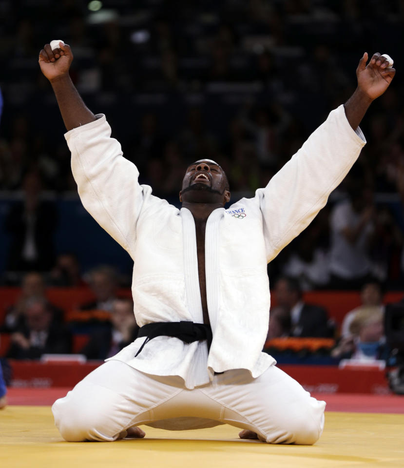 France's Teddy Riner reacts after defeating Russia's Alexander Mikhaylin to win the gold medal at the men's over 100-kg judo competition at the 2012 Summer Olympics, Friday, Aug. 3, 2012, in London. (AP Photo/Mike Groll)