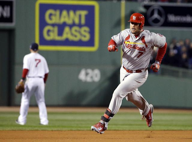 St. Louis Cardinals' Matt Holliday runs following a hit during the fourth inning of Game 2 of baseball's World Series against the Boston Red Sox Thursday, Oct. 24, 2013, in Boston. (AP Photo/Matt Slocum)