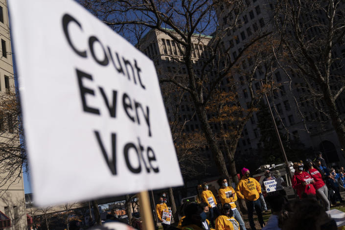 "In this Nov. 4, 2020, photo, protestors attend a rally calling for every vote to be counted from the general election near the Detroit Department of Elections building in Detroit. President-elect Joe Biden shored up the Democrats' ""blue wall,"" — more sturdily in Michigan, more tenuously in Pennsylvania and Wisconsin — to rebuild the party's path back to the White House. AP Photo/David Goldman)"