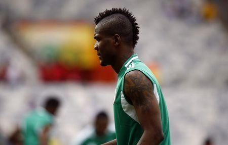 Nigeria's Brown Ideye warms up before their Confederations Cup Group B soccer match against Tahiti at the Estadio Mineirao in Belo Horizonte June 17, 2013. REUTERS/Kai Pfaffenbach/Files