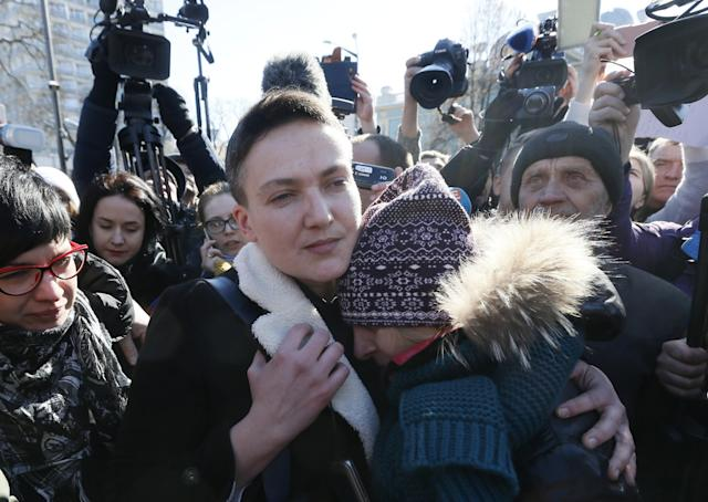 Ukrainian member of parliament Nadiya Savchenko embraces her supporter after being detained on charges of planning a military-style coup, in Kiev, Ukraine March 22, 2018. REUTERS/Valentyn Ogirenko TPX IMAGES OF THE DAY