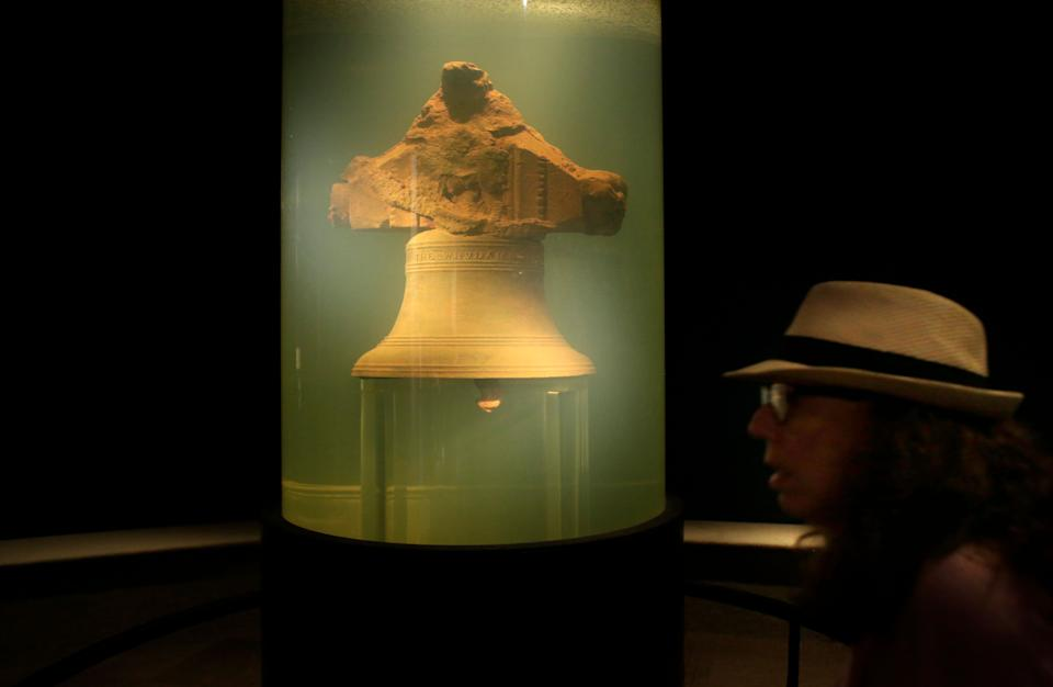 In this 2016 file photo, a museum visitor walks by a display of a bell once belonging to the pirate ship Whydah Gally at the Whydah Pirate Museum, in Yarmouth, Mass. (Photo: ASSOCIATED PRESS)