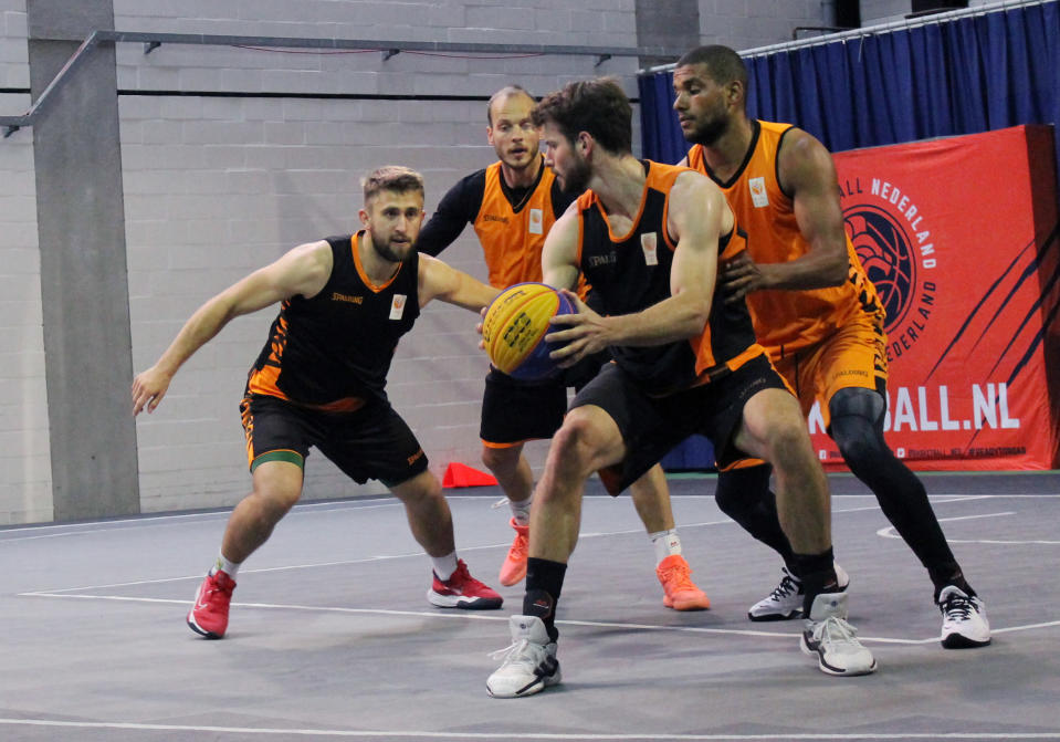 Julian Jaring, right, protects the ball from Dimeo van der Horst, second right, as Aron Roije defends Deividas Kumelis, left, during a Netherlands 3x3 basketball team practice at a court in Amsterdam, Tuesday, June 22, 2021 in preparation for the Tokyo Olympics. Three-on-three basketball debuts as an Olympic sport in Tokyo and presents traditionally overlooked basketball countries with opportunities for medals. (AP Photo/Kenneth Maguire)