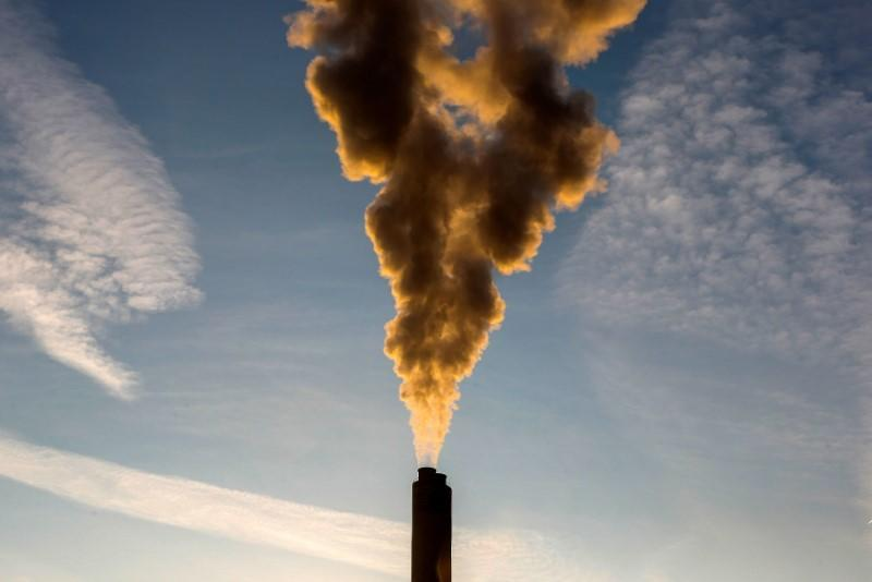 FILE PHOTO: Smoke rises from a chimney of a garbage processing plant on the outskirts of Brussels