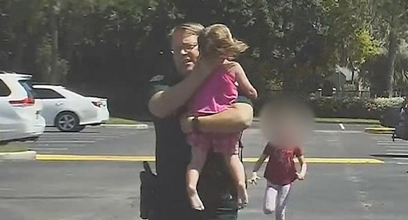 Florida police officer rescues a little girl left in a hot car.