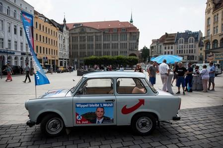 A banner on east German Traban car promotes Sebastian Wippel of Alternative for Germany (AfD) election campaign on the Marienplatz in Goerlitz