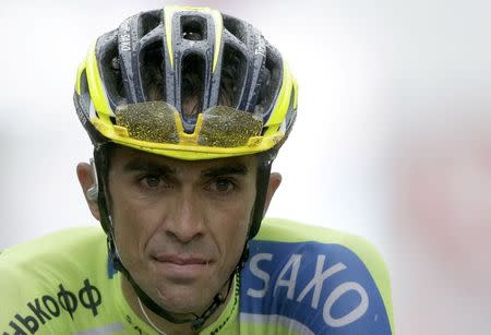 Tinkoff-Saxo team rider Alberto Contador of Spain crosses the finish line of the 161-km (100 miles) eighth stage of the Tour de France cycling race between Tomblaine and Gerardmer La Mauselaine