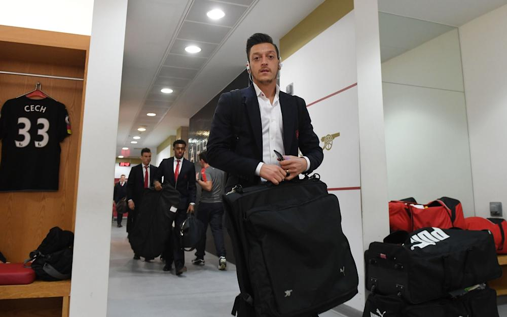 mesut Ozil in a suit - Credit: GETTY