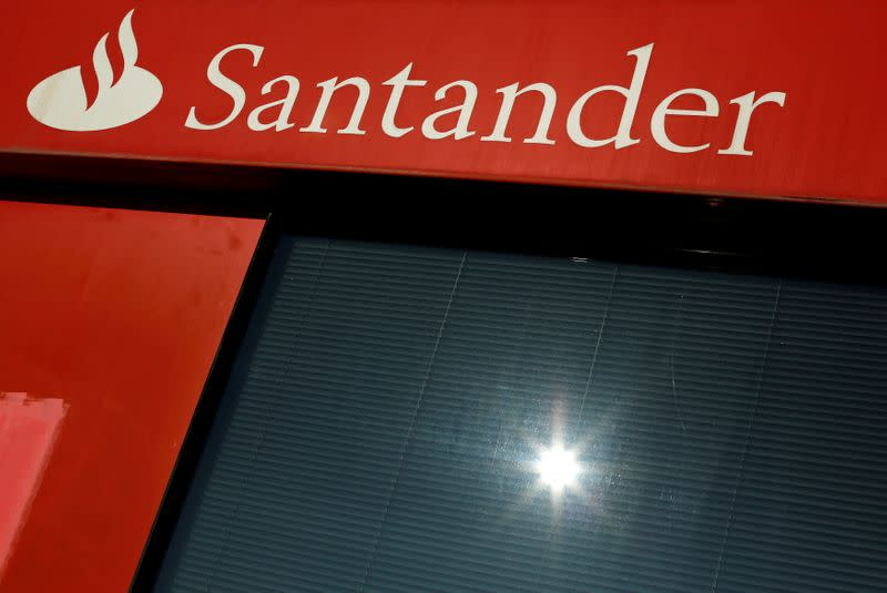 FILE PHOTO: A logo of Santander, the euro zone's largest lender by market value, is seen on a branch in the Andalusian capital of Seville