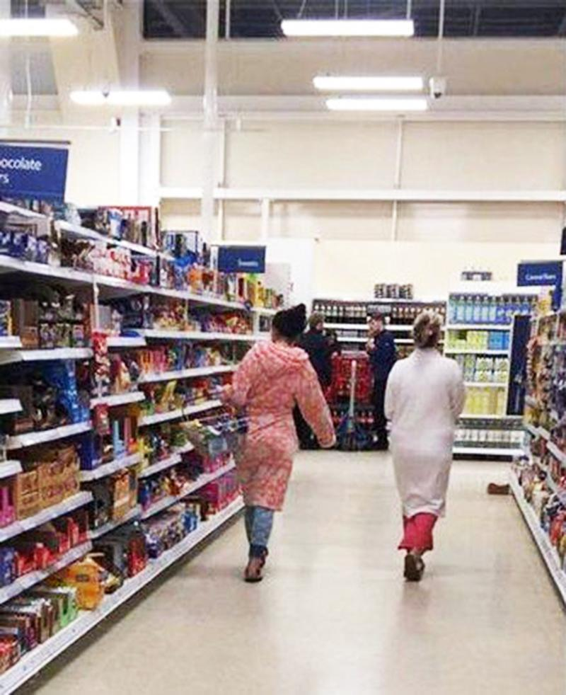 One man was disturbed by the state of dress of these women in a British grocer. (Photo: Joel Brackenbury/Facebook)