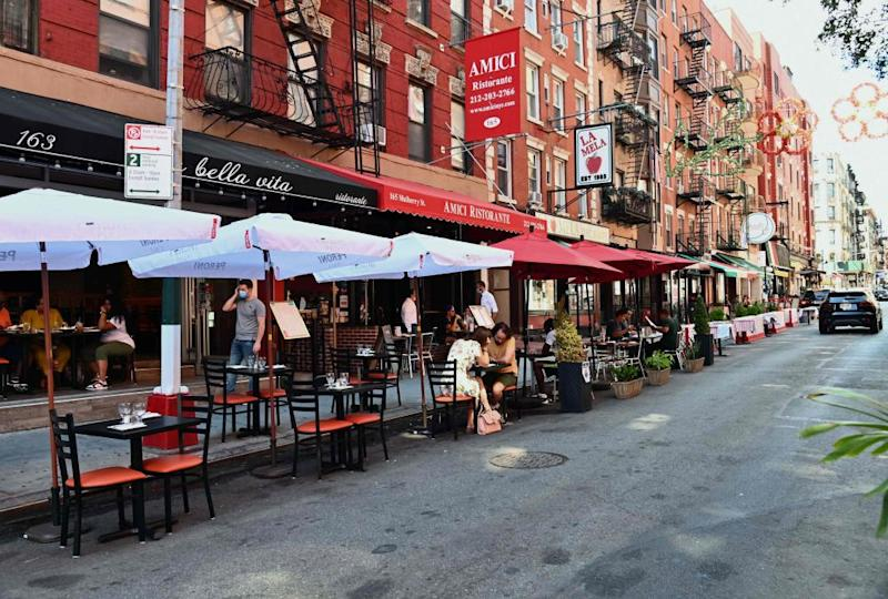 Outdoor dining at a restaurant in the Little Italy neighborhood. New York City will not proceed with indoor dining from next week as planned because of a nationwide surge in coronavirus.
