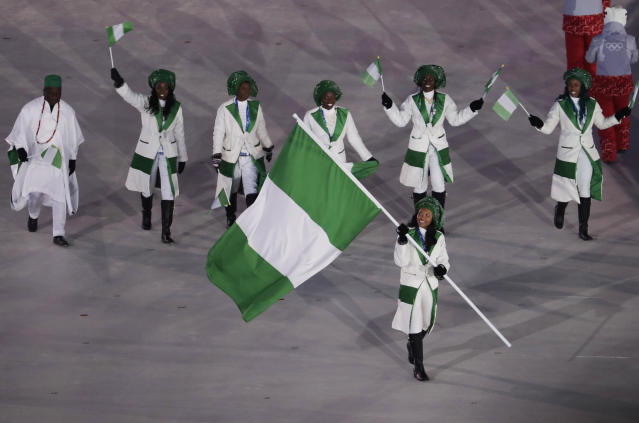 <p>Ngozi Onwumere carries the flag of Nigeria during the opening ceremony of the 2018 Winter Olympics in Pyeongchang, South Korea, Friday, Feb. 9, 2018. (AP Photo/Natacha Pisarenko) </p>