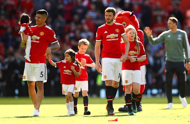 "Soccer Football - Premier League - Manchester United vs Watford - Old Trafford, Manchester, Britain - May 13, 2018 Manchester United's Michael Carrick and Marcos Rojo alongside their children after the match Action Images via Reuters/Jason Cairnduff EDITORIAL USE ONLY. No use with unauthorized audio, video, data, fixture lists, club/league logos or ""live"" services. Online in-match use limited to 75 images, no video emulation. No use in betting, games or single club/league/player publications. Please contact your account representative for further details."