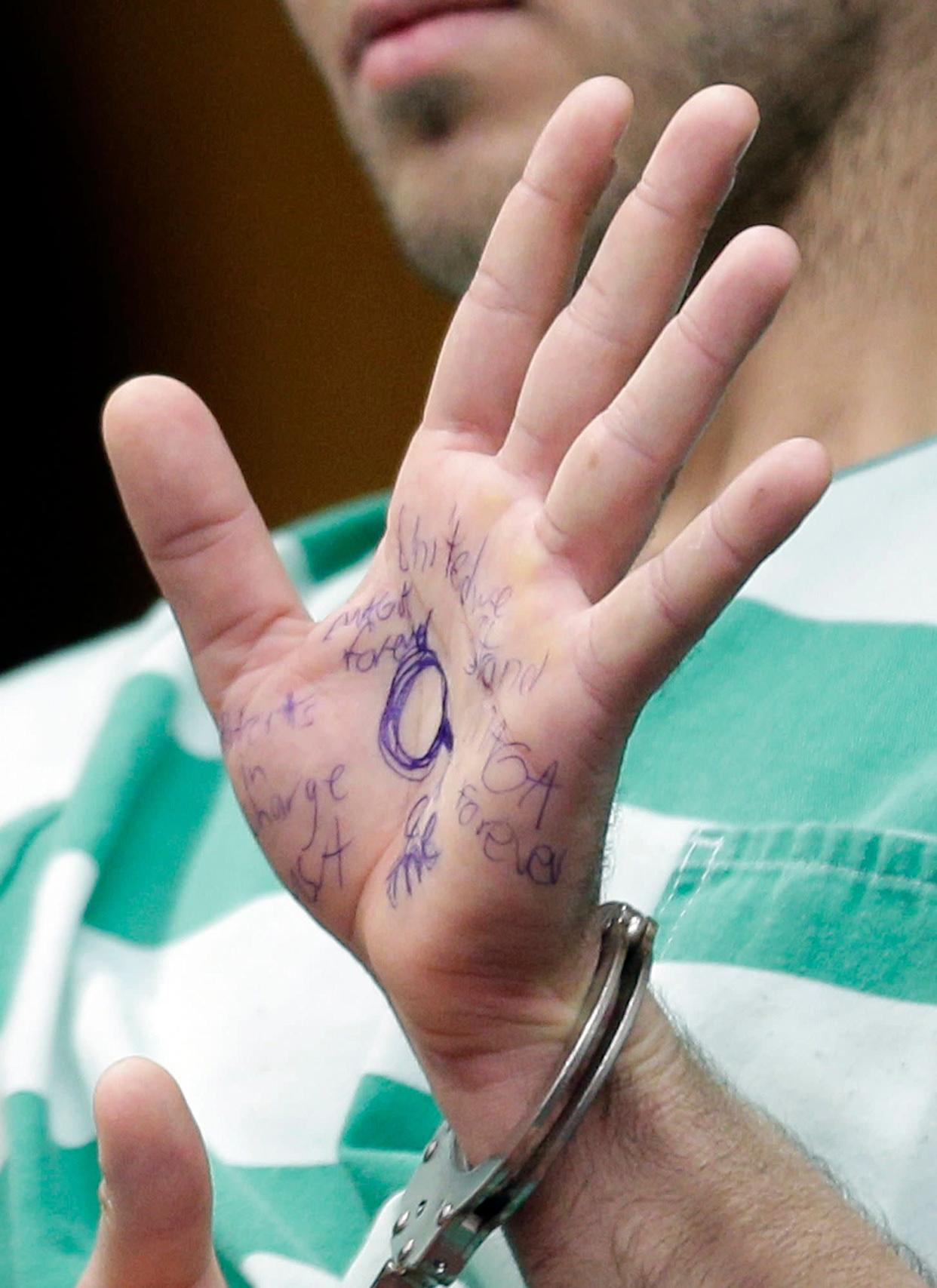 Anthony Comello's hand was covered in pro-Trump messages penned with blue ink. (Photo: ASSOCIATED PRESS)
