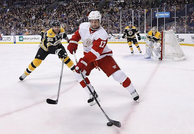 Detroit Red Wings' David Legwand (17) and Boston Bruins' Zdeno Chara (33) battle for the puck during the first period in Game 5 in the first round of the NHL hockey Stanley Cup playoffs in Boston, Saturday, April 26, 2014. (AP Photo/Michael Dwyer)