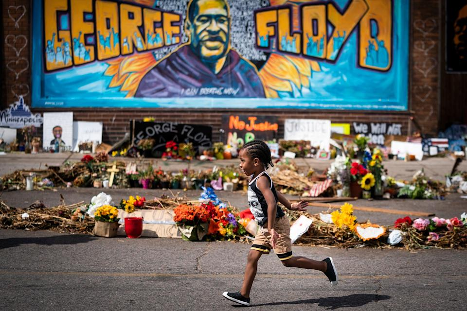 <p>In this June 25, 2020 file photo, Carter Sims, 3, of Pine Island, Minn., runs past a mural at the George Floyd memorial outside Cup Foods in Minneapolis.  A stretch of a Minneapolis street that includes the place where Floyd was killed will soon be named in his honor.  The City Council approved the naming Friday, Sept. 18, and Mayor Jacob Frey's office said he would likely sign off on it as well.  (Leila Navidi/Star Tribune via AP, File)</p> (© 2020 Leila Navidi/Star Tribune)