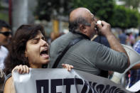 A woman chants slogans outside the Finance Ministry in Athens, on Thursday, Sept. 13, 2012. Disabled groups are angry at likely benefit cuts under a major new austerity program demanded by international rescue creditors. (AP Photo/Petros Giannakouris)