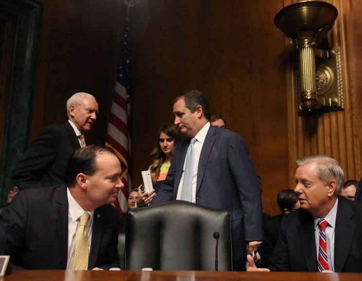 Sen. Mike Lee (R-UT) (L), talks with Sen. Lindsey Graham (R-SC), as Sen. Orrin Hatch (R-UT) and Sen. Ted Cruz (R-TX) stand nearby on Capitol Hill in Washington, D.C. Graham is the only senator pictured to not sign the climate letter to President Trump. (Photo: Mark Wilson/Getty Images)