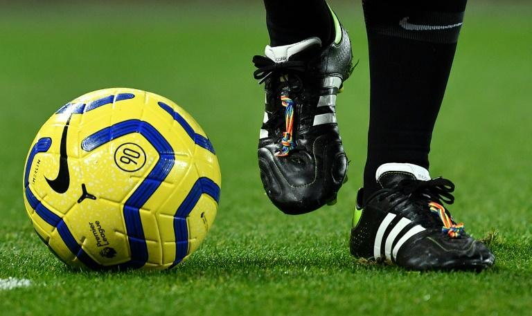 """There are no openly gay or bisexual players in the English men's Premier League, but major clubs have implemented zero-tolerance policies for homophobia and embraced the """"rainbow laces"""" campaign against discrimination (AFP Photo/Paul ELLIS)"""
