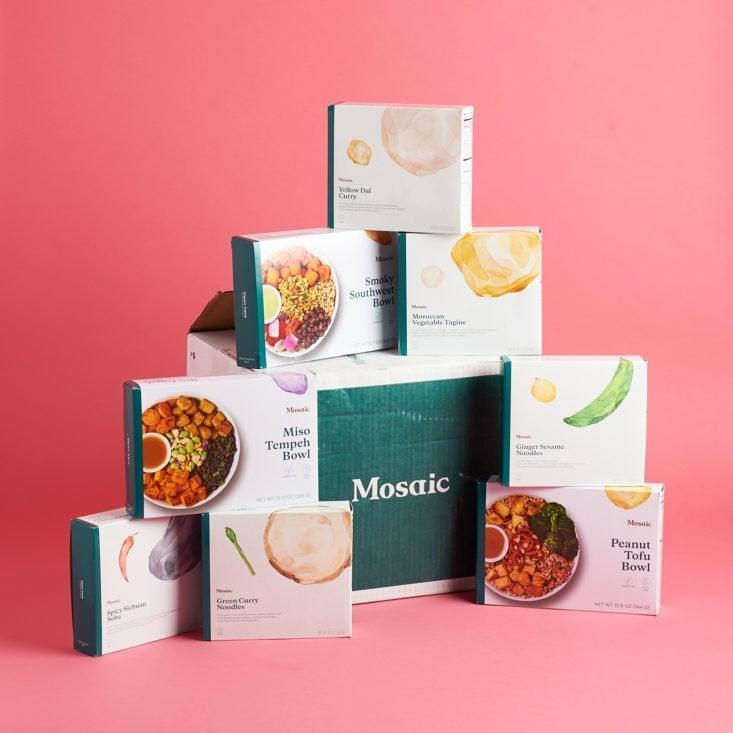 """<h2>Mosaic Foods</h2><br><strong>The slogan:</strong> """"Our chef's source fresh produce and hearty whole grains from the Hudson Valley, then prep and cook by hand. Pick from our delicious menu of nutritious breakfast, lunch, and dinner options, and let us do the rest of the work.""""<br><br>What you get: Real vegan food made with real ingredients, including those you can pronounce. Each plant-based meal is packed with fiber, protein, and micronutrients to keep you feeling satisfied and healthy. You'll find everything from <a href=""""https://www.mosaicfoods.com/collections/veggie-bowls"""" rel=""""nofollow noopener"""" target=""""_blank"""" data-ylk=""""slk:Peanut Tofu Bowls to Greek Jackfruit Bowls"""" class=""""link rapid-noclick-resp"""">Peanut Tofu Bowls to Greek Jackfruit Bowls</a>. <br><br>The delivery: Everything arrives in a cooled, insulated box with free shipping on orders over $100. Pick between every 1, 2, or 4 weeks with their quick, recyclable delivery. <br><br><em>Shop <strong><a href=""""https://www.mosaicfoods.com/"""" rel=""""nofollow noopener"""" target=""""_blank"""" data-ylk=""""slk:Mosaic Foods"""" class=""""link rapid-noclick-resp"""">Mosaic Foods</a></strong></em>"""