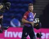 England's Jos Buttler smiles as he walks off the pitch after England won the T20 international cricket match between England and Sri Lanka at Cardiff, Wales, Wednesday, June 23, 2021. (AP Photo/Alastair Grant)