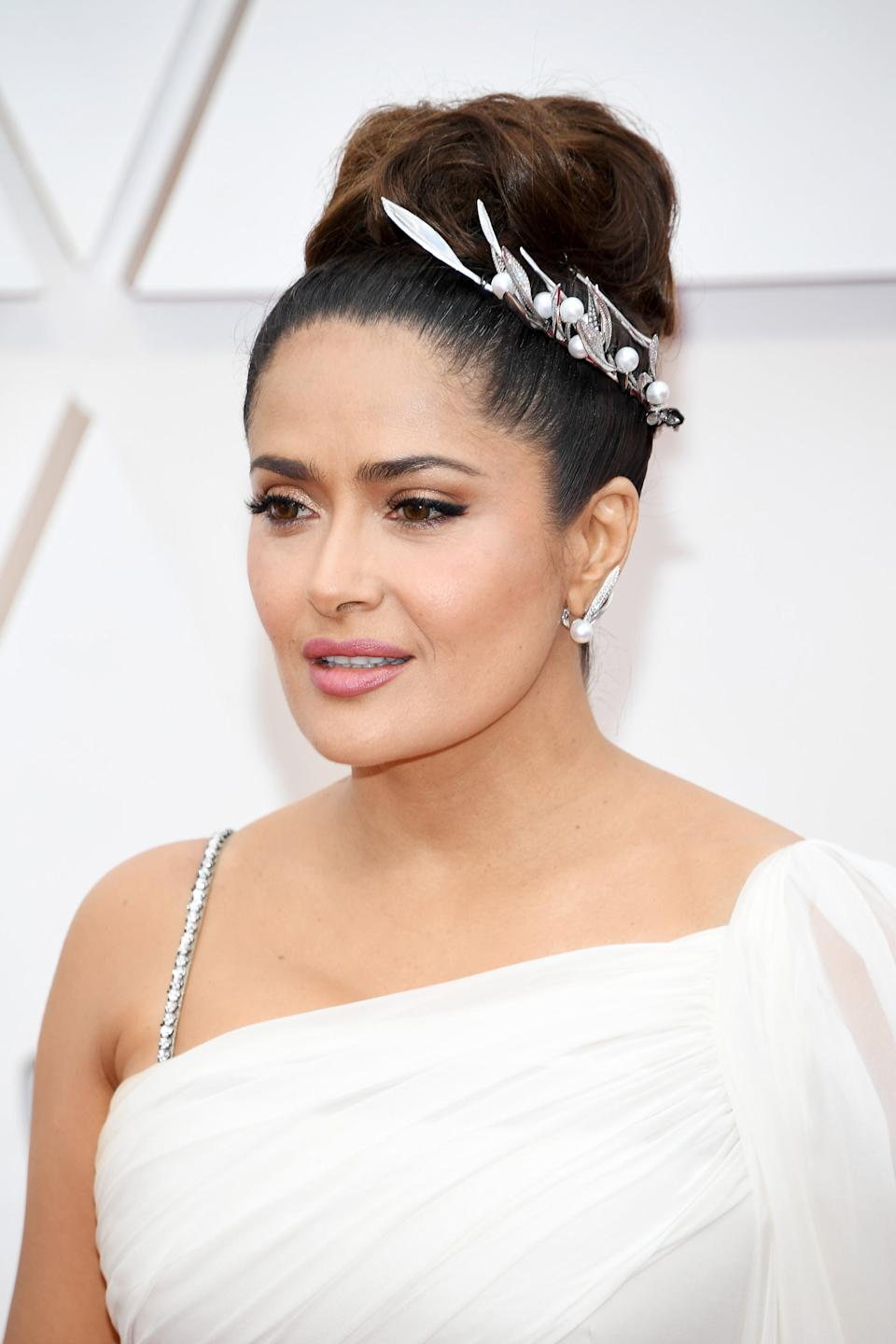 """Jennifer Yepez topped off Salma Hayek's ethereal updo with a beaded hair clip with pearl and leafy details.<span class=""""copyright""""> Photo: Kevin Mazur/Getty Images.</span>"""