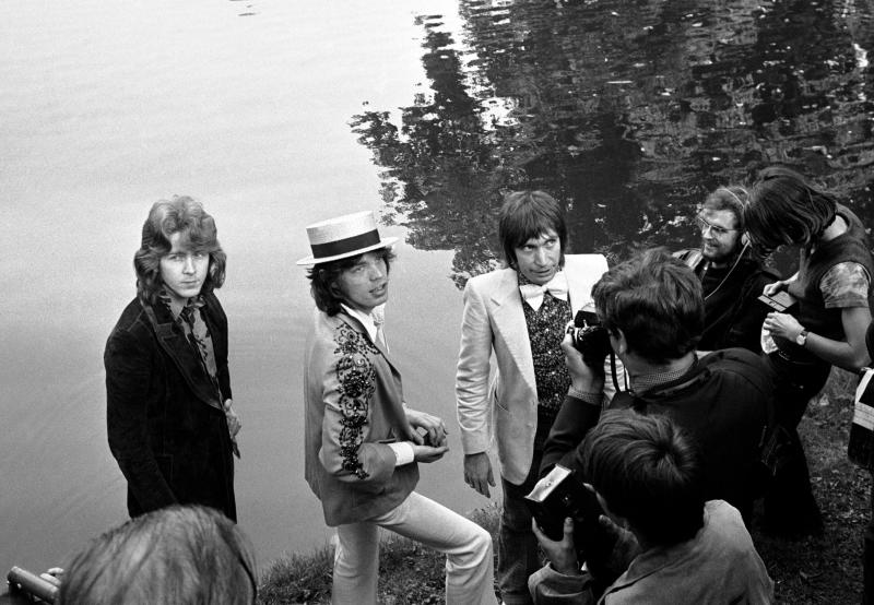 "FILE - This Sept. 22 1970 file photo shows Mick Jagger, center, lead singer of The Rolling Stones pop music group, with a straw hat, as he and guitarist Mick Taylor and drummer Charlie Watts, right in bow tie, pose during a press conference at the Bois de Boulogne in Paris, France . In 1972, The Rolling Stones controversially moved to the south of France to escape onerous British taxes. Though it caused a stink at the time, it spawned one of the group's most seminal albums, ""Exile on Main St."" The title is a reference to their tax-dodging. (AP Photo, Cardenas, File)"