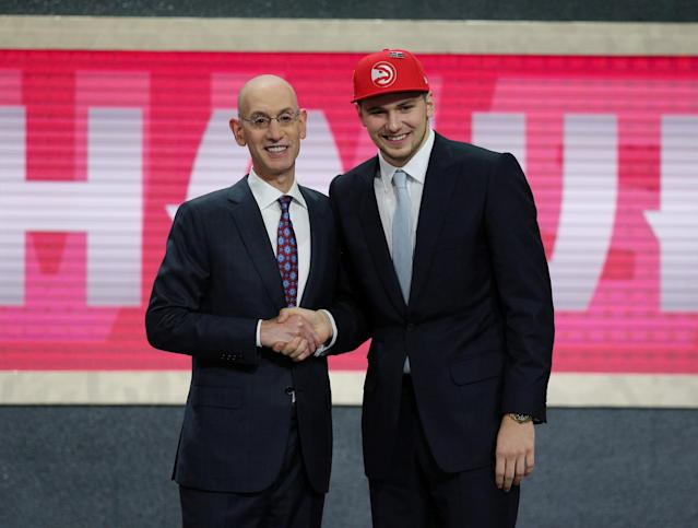 FILE PHOTO: Luka Doncic greets NBA commissioner Adam Silver (L) after being selected as the number three overall pick to the Atlanta Hawks in the first round of the 2018 NBA Draft at the Barclays Center in Brooklyn, NY, U.S., June 21, 2018. Mandatory Credit: Brad Penner-USA TODAY Sports/File Photo
