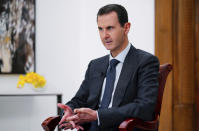 FILE - In this file photo released Monday Nov. 9, 2019 by the Syrian official news agency SANA, Syrian President Bashar Assad speaks in Damascus, Syria. The unprecedented public crackdown on Syria's wealthiest businessman Rami Makhlouf,, a close cousin of Bashar Assad, comes as the embattled president seeks to consolidate power and rein in war profiteers. Syria is preparing for a new phase of economic hardship and U.S.-led sanctions that some say might be more difficult to weather than war. (SANA via AP,File)