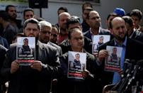 Palestinian journalists carry a portrait of journalist Yasser Murtaja, during his funeral in Gaza City on April 7, 2018