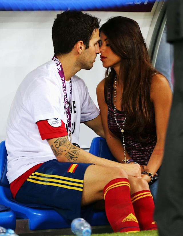 KIEV, UKRAINE - JULY 01: Cesc Fabregas of Spain kisses his girlfriend Daniella Semaan on the substitutes bench following his team's victory in the UEFA EURO 2012 final match between Spain and Italy at the Olympic Stadium on July 1, 2012 in Kiev, Ukraine. (Photo by Alex Grimm/Getty Images)