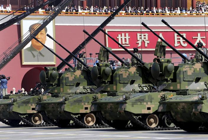 Anti-aircraft artilleries drive past Tiananmen Gate during a military parade to mark the 70th anniversary of the end of World War Two, in Beijing, China, September 3, 2015. REUTERS/Jason Lee