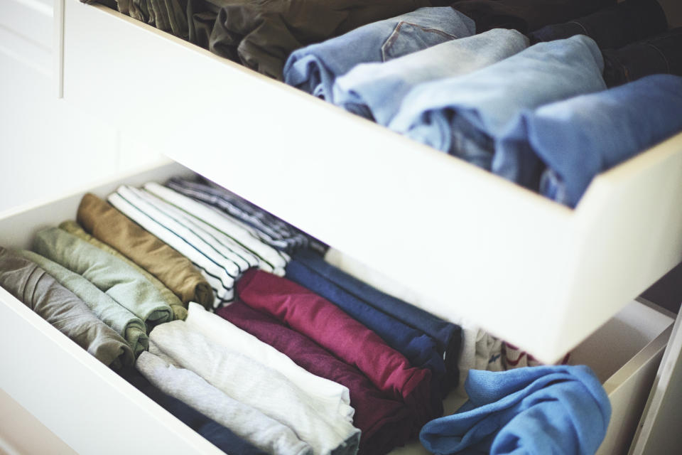 A closet filled with clothes.