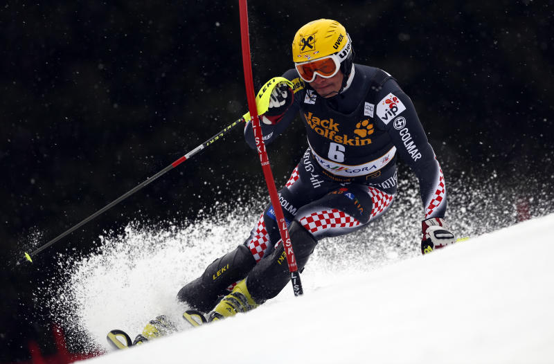 Croatia's Ivica Kostelic speeds down the slope on his way to clock the third fastest time during the first run of an alpine ski, men's World Cup slalom, in Kranjska Gora, Slovenia, Sunday, March 10, 2013. (AP Photo/Alessandro Trovati)
