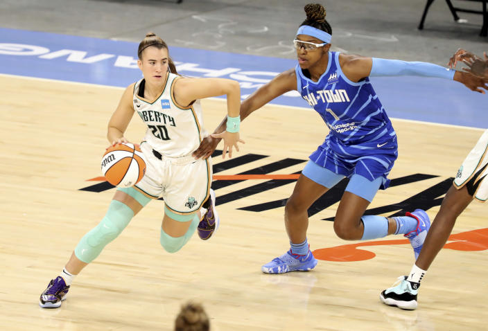 New York Liberty guard Sabrina Ionescu (20) tries to get past Chicago Sky guard Diamond DeShields (1) during a WNBA game Sunday, May 23, 2021 in Chicago. (AP Photo/Eileen T. Meslar)