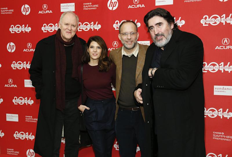 """File-This Jan. 18, 2014, file photo shows Writer and director Ira Sachs, second right, poses with cast members from left to right, John Lithgow, Marisa Tomei, and Alfred Molina at the premiere of the film """"Love is Strange"""" during the 2014 Sundance Film Festival, in Park City, Utah. (Photo by Danny Moloshok/Invision/AP)"""