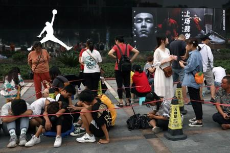 People queue outside a Nike's Air Jordan store before the new Air Jordan 1 sneakers go on sale in Yichang, Hubei