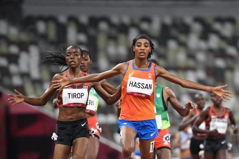 Sifan Hassan celebrates as she crosses the finish line in her heat of the Olympic women's 5000 metres