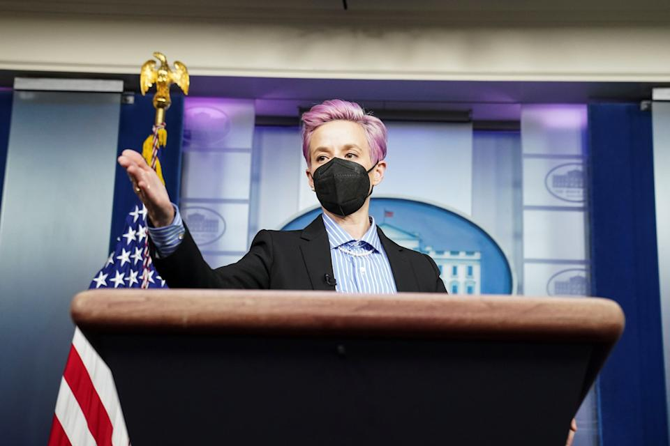 U.S. Women's National Soccer Team player Megan Rapinoe, visiting Biden administration members on 'Equal Pay Day' symbolic of the gender pay gap, poses for pictures at the lectern in the press briefing room at the White House in Washington, U.S., March 24, 2021. REUTERS/Kevin Lamarque