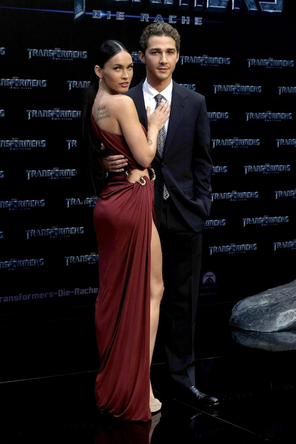 """<p>During one of Megan and Brian's breakups, there were rumors that Megan was romantically involved with her <strong>Transformers</strong> costar. Megan and Shia filmed <strong>Transformers</strong> in 2007 and a sequel in 2009. In an interview with <strong>Details</strong> magazine in 2011, Shia confirmed that <a href=""""https://www.huffpost.com/entry/megan-fox-dated-shia-labeouf_n_5c015702e4b0d04f48b3a95f"""" class=""""link rapid-noclick-resp"""" data-ylk=""""slk:he and Megan were once romantic"""">he and Megan were once romantic</a>. """"Look, you're on the set for six months with someone who's rooting to be attracted to you, and you're rooting to be attracted to them,"""" he explained. """"I never understood the separation of work and life in that situation. But the time I spent with Megan was our own thing.""""</p> <p>However, it wasn't until 2018 that <a href=""""https://www.popsugar.com/celebrity/Megan-Fox-Confirms-Relationship-Shia-LaBeouf-45538541"""" class=""""link rapid-noclick-resp"""" rel=""""nofollow noopener"""" target=""""_blank"""" data-ylk=""""slk:Megan finally confirmed the rumors herself"""">Megan finally confirmed the rumors herself</a> on Andy Cohen's <strong>Watch What Happens Live!</strong>. When asked if she and Shia ever dated, Megan replied, """"I mean, I would confirm it was romantic.""""</p>"""