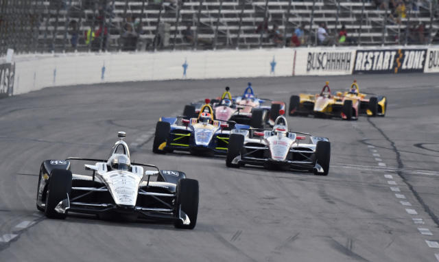 Simon Pagenaud (22), of France, heads into Turn 1 during the IndyCar auto race Saturday, June 9, 2018, in Fort Worth, Texas. (AP Photo/Larry Papke)