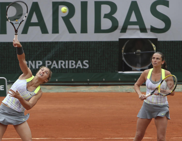 Italy's Sara Errani, left, and Roberta Vinci, right, return against Russia's Ekaterina Makarova and Elena Vesnina in the women's doubles final of the French Open tennis tournament, at Roland Garros stadium in Paris, Sunday June 9, 2013. (AP Photo/David Vincent)