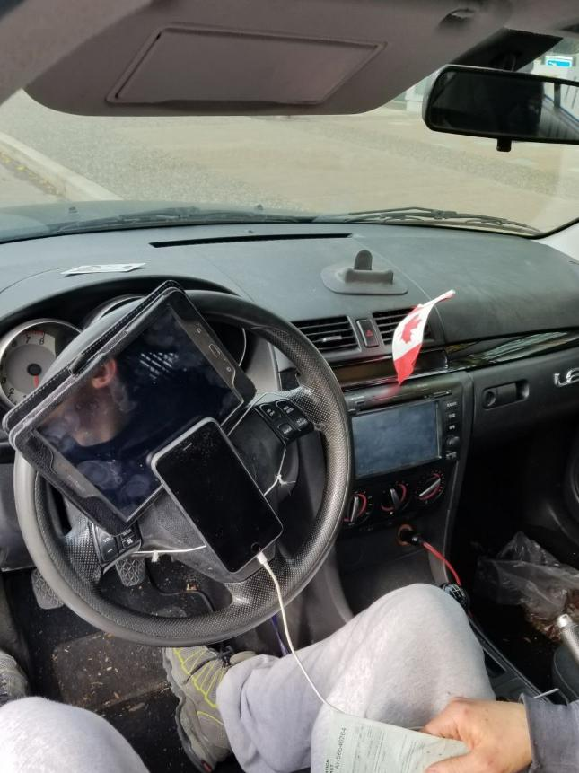 Traffic police fined a driver in Vancouver after he was found to have his phone and tablet strapped to his steering wheel: Vancouver Police / Twitter